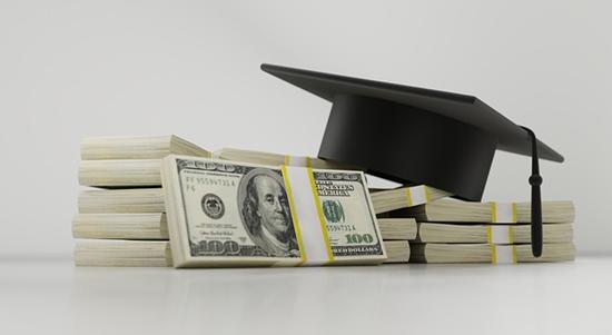 graduation hat on a pile of cash