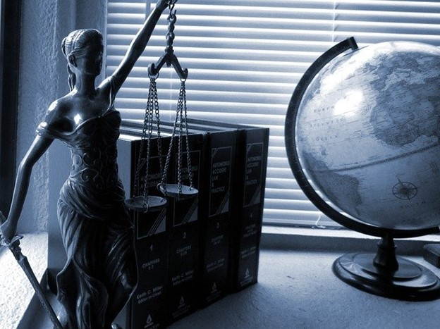 lady justice and a globe