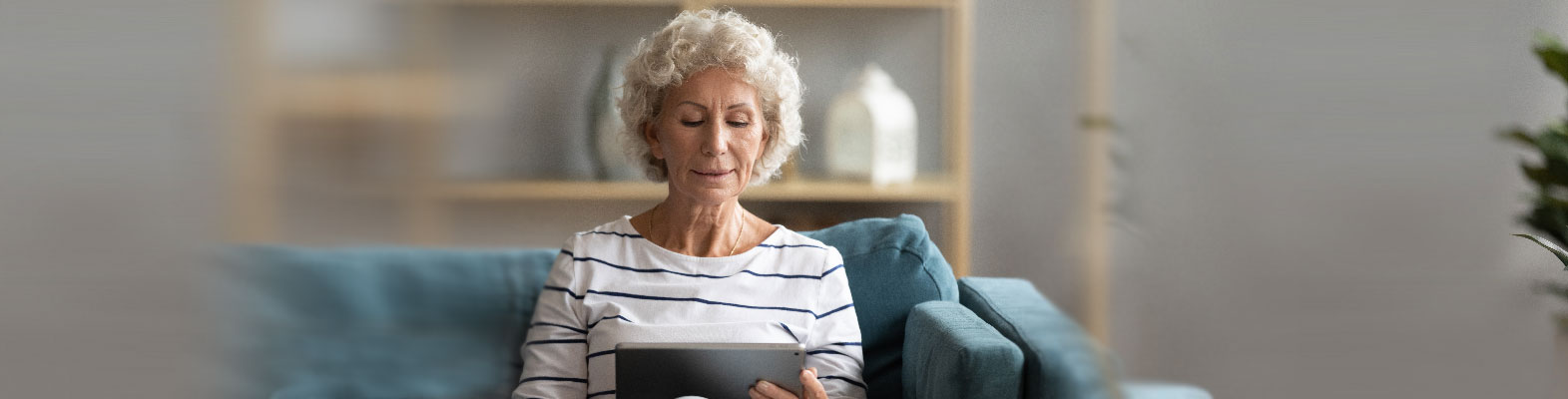 older woman looking at her tablet